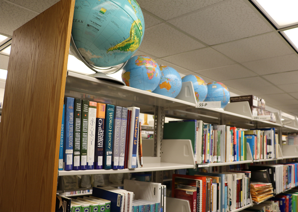 Shelf of books and teacher resources at the UD Education Resource Center